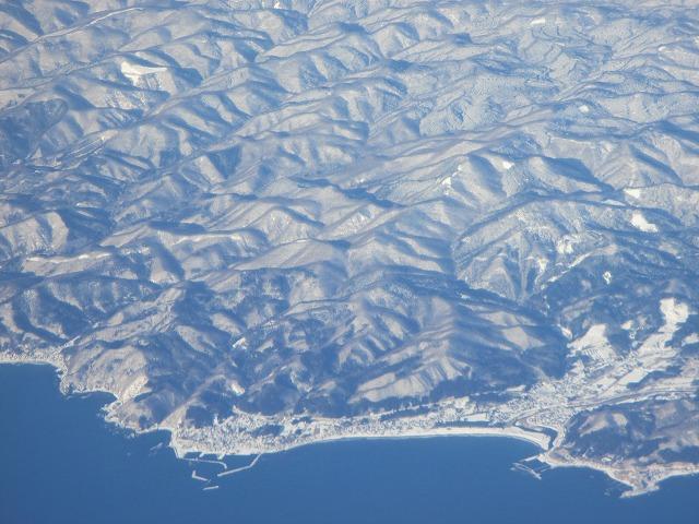上空からの雪山の景色